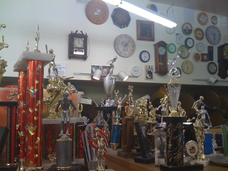 Then there's more random stuff on shelves and walls, like these trophies and clocks.